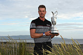 Henrik Stenson of Sweden poses with the Claret Jug on Troon Beach following his victory during the final round on day four of the 145th Open...