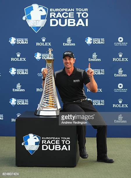 Henrik Stenson of Sweden poses with the Race To Dubai trophy after winning the Race To Dubai at the DP World Tour Championship on the Earth Course at...