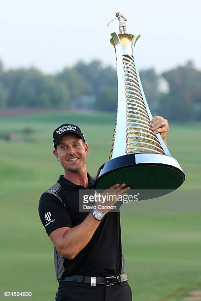 Henrik Stenson of Sweden poses with the Race to Dubai trophy during day four of the DP World Tour Championship at Jumeirah Golf Estates on November...