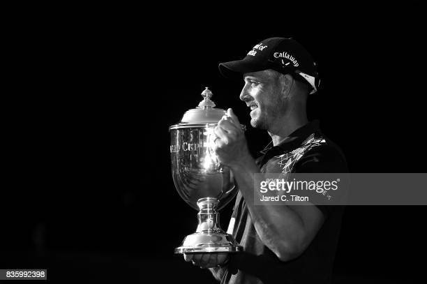 Henrik Stenson of Sweden poses with the trophy after winning the Wyndham Championship at Sedgefield Country Club on August 20 2017 in Greensboro...