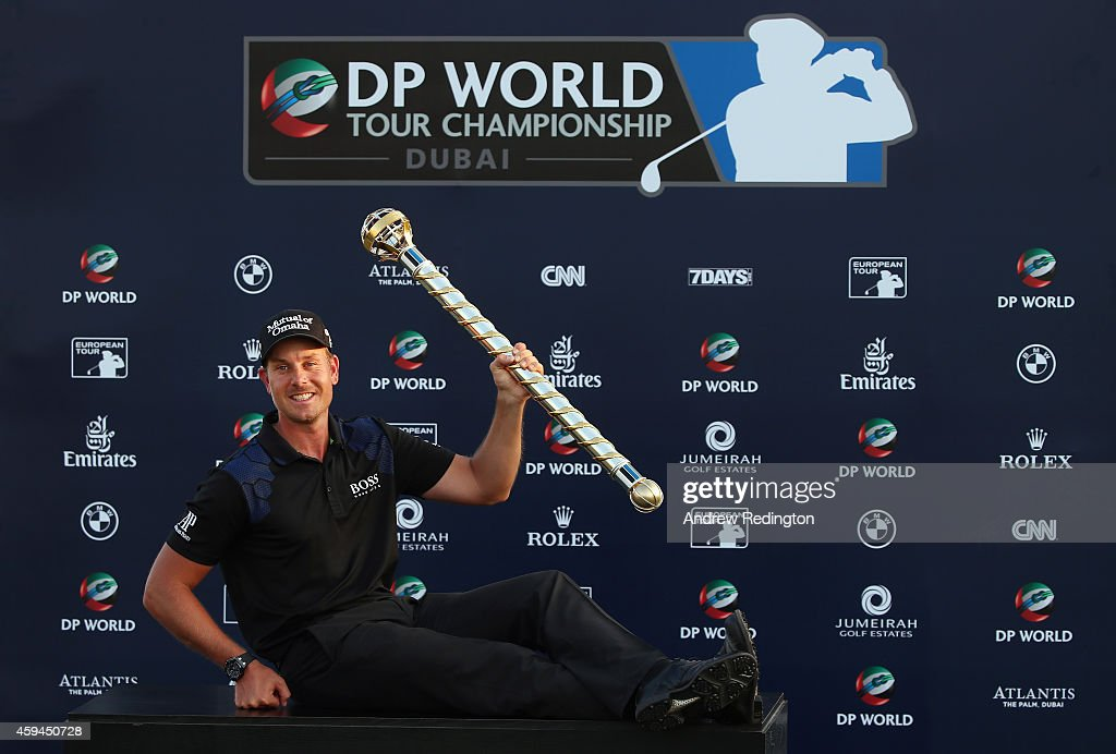 <a gi-track='captionPersonalityLinkClicked' href=/galleries/search?phrase=Henrik+Stenson&family=editorial&specificpeople=211537 ng-click='$event.stopPropagation()'>Henrik Stenson</a> of Sweden poses with the trophy after winning the DP World Tour Championship at Jumeirah Golf Estates on November 23, 2014 in Dubai, United Arab Emirates.