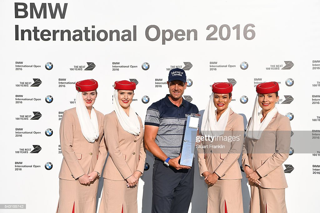 <a gi-track='captionPersonalityLinkClicked' href=/galleries/search?phrase=Henrik+Stenson&family=editorial&specificpeople=211537 ng-click='$event.stopPropagation()'>Henrik Stenson</a> of Sweden poses with the trophy and the Emirates girls following his 3 shot victory during the final round of the BMW International Open at Gut Larchenhof on June 26, 2016 in Cologne, Germany.
