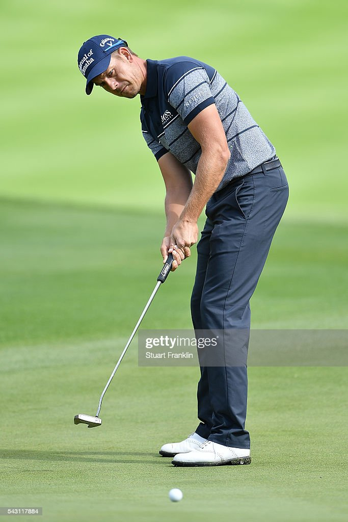 <a gi-track='captionPersonalityLinkClicked' href=/galleries/search?phrase=Henrik+Stenson&family=editorial&specificpeople=211537 ng-click='$event.stopPropagation()'>Henrik Stenson</a> of Sweden putts during the rain delayed third round of the BMW International Open at Gut Larchenhof on June 26, 2016 in Cologne, Germany.