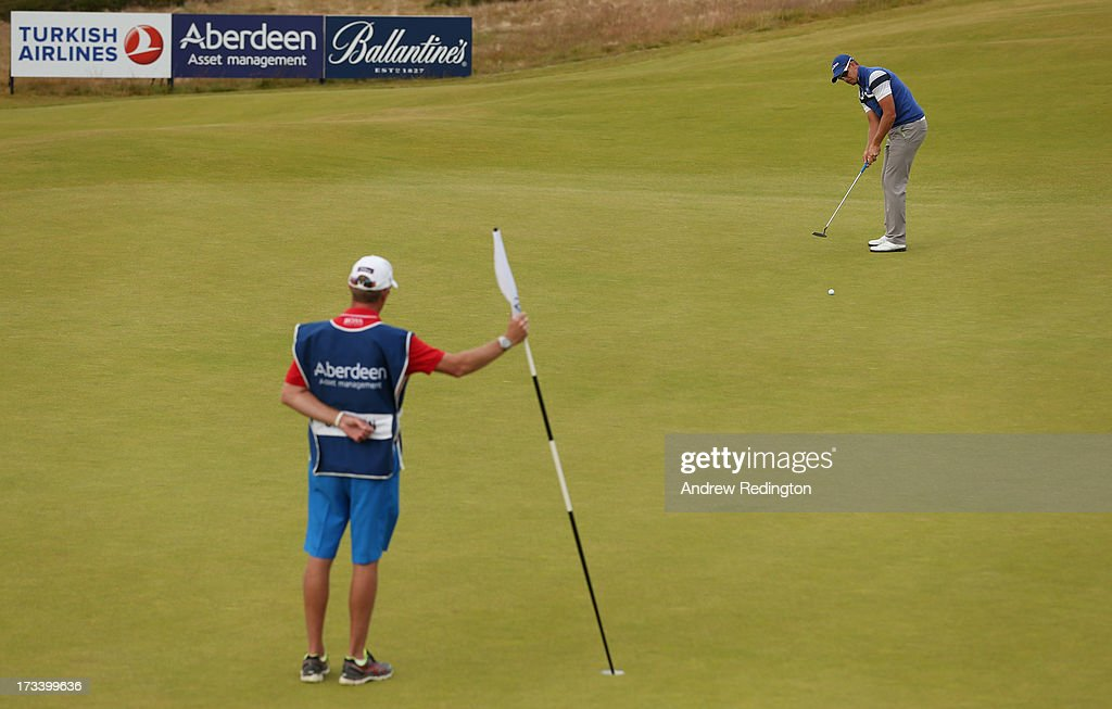 <a gi-track='captionPersonalityLinkClicked' href=/galleries/search?phrase=Henrik+Stenson&family=editorial&specificpeople=211537 ng-click='$event.stopPropagation()'>Henrik Stenson</a> of Sweden putts on the 17th green during the third round of the Aberdeen Asset Management Scottish Open at Castle Stuart Golf Links on July 13, 2013 in Inverness, Scotland.