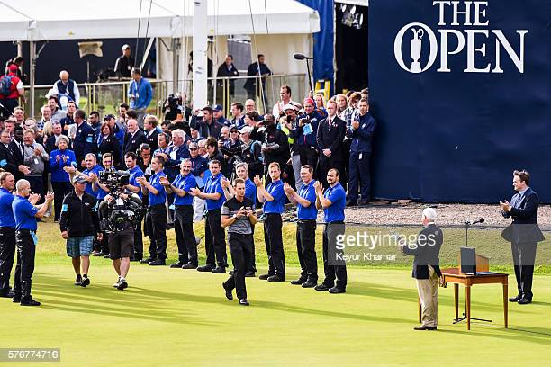 Henrik Stenson of Sweden reaches for the Claret Jug following his three stroke victory during the final round on day four of the 145th Open...