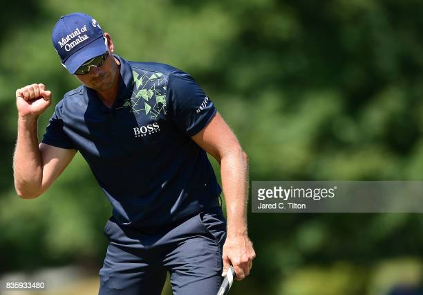 Henrik Stenson of Sweden reacts after making his birdie putt on the seventh green during the final round of the Wyndham Championship at Sedgefield...
