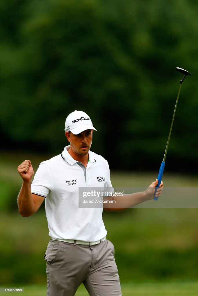 <a gi-track='captionPersonalityLinkClicked' href=/galleries/search?phrase=Henrik+Stenson&family=editorial&specificpeople=211537 ng-click='$event.stopPropagation()'>Henrik Stenson</a> of Sweden reacts after putting for birdie on the 11th green during the final round of the Deutsche Bank Championship at TPC Boston on September 2, 2013 in Norton, Massachusetts.
