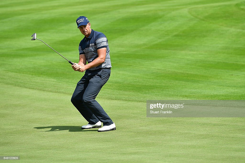 <a gi-track='captionPersonalityLinkClicked' href=/galleries/search?phrase=Henrik+Stenson&family=editorial&specificpeople=211537 ng-click='$event.stopPropagation()'>Henrik Stenson</a> of Sweden reacts during the rain delayed third round of the BMW International Open at Gut Larchenhof on June 26, 2016 in Cologne, Germany.