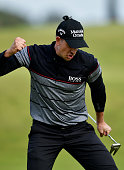 Henrik Stenson of Sweden reacts to a birdie putt on the 15th during the final round on day four of the 145th Open Championship at Royal Troon on July...