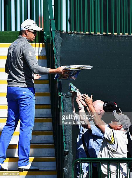 Henrik Stenson of Sweden signs autographs before a practice round prior to the start of The 143rd Open Championship at Royal Liverpool on July 15...