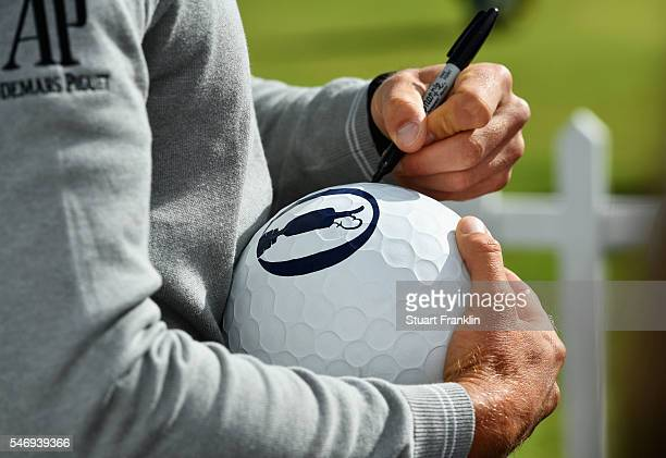 Henrik Stenson of Sweden signs autographs during previews ahead of the 145th Open Championship at Royal Troon on July 13 2016 in Troon Scotland