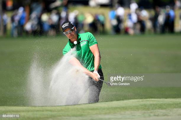 Henrik Stenson of Sweden splashes out of a bunker at No 6 during the second round of the Arnold Palmer Invitational presented by MasterCard at Bay...