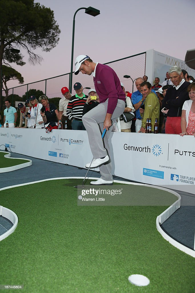 <a gi-track='captionPersonalityLinkClicked' href=/galleries/search?phrase=Henrik+Stenson&family=editorial&specificpeople=211537 ng-click='$event.stopPropagation()'>Henrik Stenson</a> of Sweden takes part in the Genworth Putts4Charity Challenge Series Final after the second round of the Turkish Airlines Open at The Montgomerie Maxx Royal Course on November 8, 2013 in Antalya, Turkey.