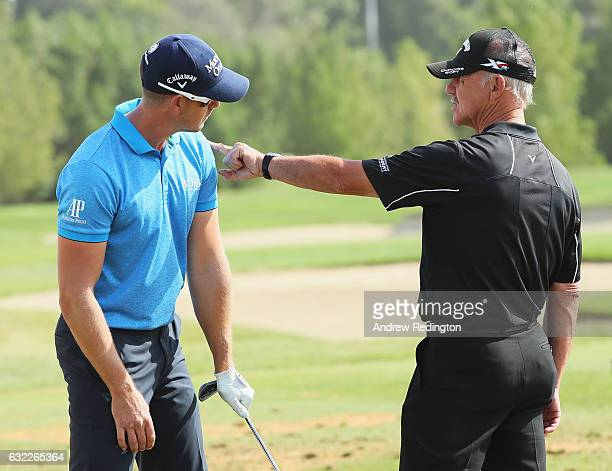 Henrik Stenson of Sweden talks with coach Pete Cowen on the range during the third round of the Abu Dhabi HSBC Championship at the Abu Dhabi Golf...