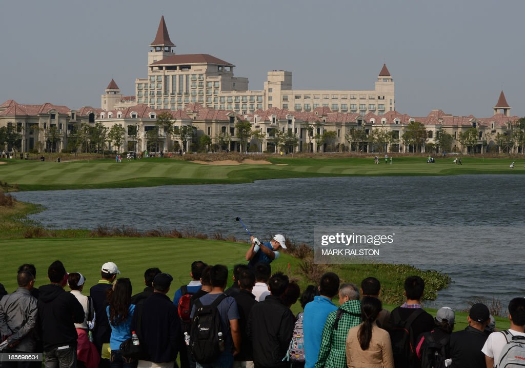 Henrik Stenson of Sweden tees off at the 9th hole during day one the BMW Shanghai Masters golf tournament at the Lake Malaren Golf Club in Shanghai on October 24, 2013. The 7 million USD event is being held for the second time at the Lake Malaren Golf Club. AFP PHOTO/Mark RALSTON