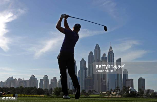 TOPSHOT Henrik Stenson of Sweden tees off during the third round of the Omega Dubai Desert Classic at the Emirates Golf Club on February 4 2017 in...