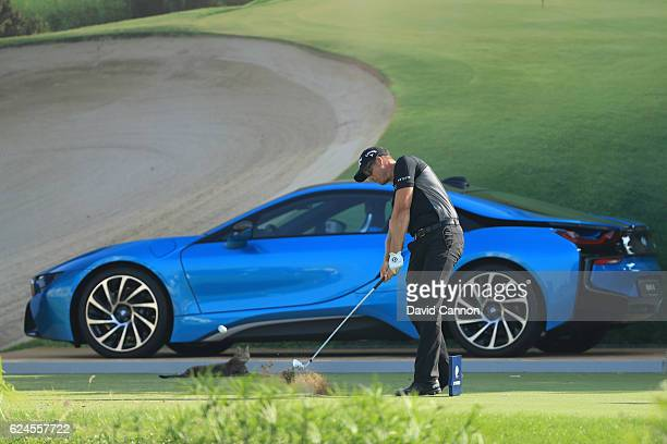 Henrik Stenson of Sweden tees off on the 17th hole watched by a cat during day four of the DP World Tour Championship at Jumeirah Golf Estates on...