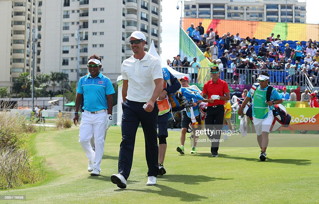 Henrik Stenson of Sweden, Thongchai Jaidee of Thailand and Rafa Cabrera Bello of Spain walk from the first tee during the first round of men's golf on Day 6 of the Rio 2016 Olympics at the Olympic Golf Course on August 12, 2016 in Rio de Janeiro, Brazil.