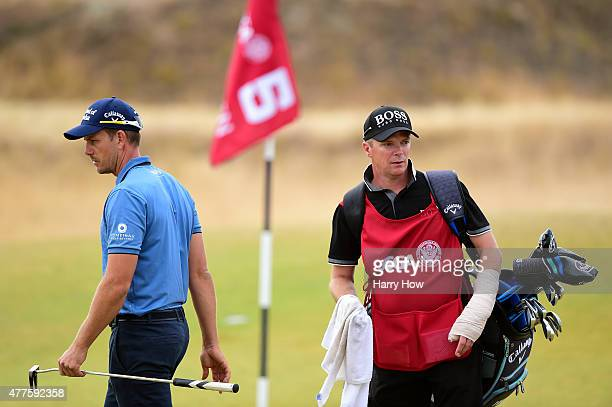 Henrik Stenson of Sweden waits with his caddie Gareth Lord on the fifth green during the first round of the 115th US Open Championship at Chambers...