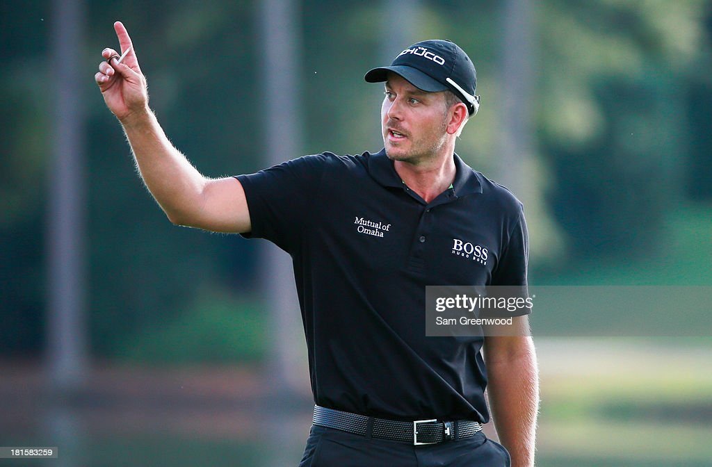 <a gi-track='captionPersonalityLinkClicked' href=/galleries/search?phrase=Henrik+Stenson&family=editorial&specificpeople=211537 ng-click='$event.stopPropagation()'>Henrik Stenson</a> of Sweden walks across the 17th green during the final round of the TOUR Championship by Coca-Cola at East Lake Golf Club on September 22, 2013 in Atlanta, Georgia.