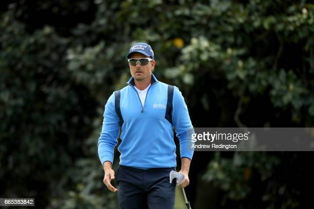 Henrik Stenson of Sweden walks across the first green during the first round of the 2017 Masters Tournament at Augusta National Golf Club on April 6...