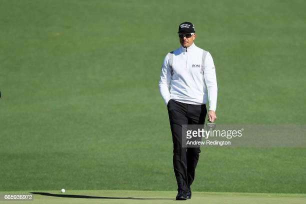 Henrik Stenson of Sweden walks across the second green during the second round of the 2017 Masters Tournament at Augusta National Golf Club on April...