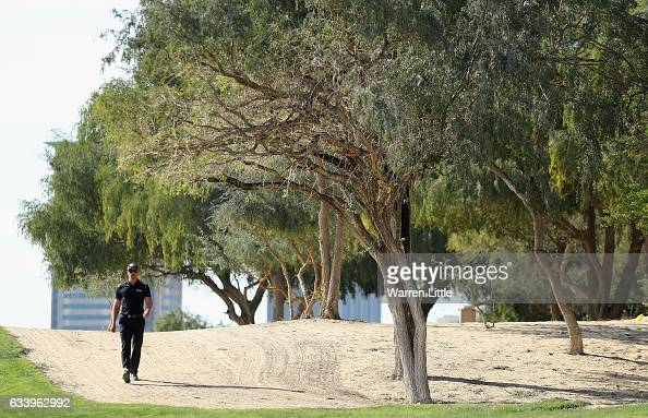 Henrik Stenson of Sweden walks down the 13th hole during the final round of the Omega Dubai Desert Classic on the Majlis course at Emirates Golf Club...