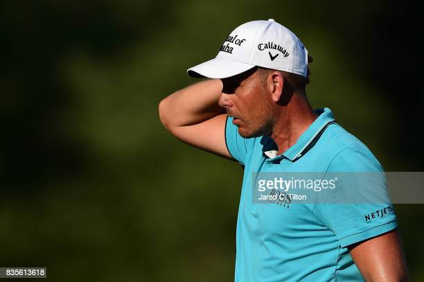 Henrik Stenson of Sweden walks off the 18th green during the third round of the Wyndham Championship at Sedgefield Country Club on August 19 2017 in...