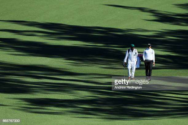 Henrik Stenson of Sweden walks with caddie Gareth Lord on the second hole during the second round of the 2017 Masters Tournament at Augusta National...