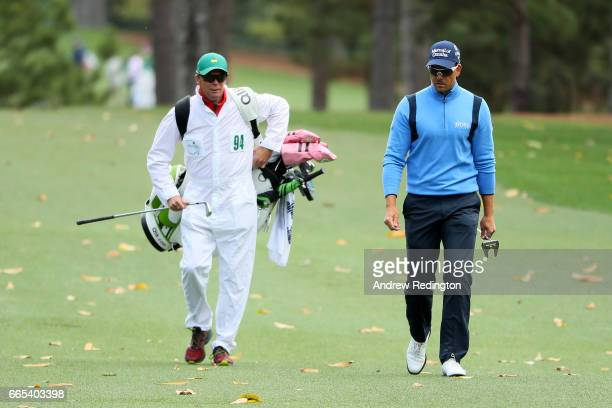 Henrik Stenson of Sweden walks with his caddie Gareth Lord on the first hole during the first round of the 2017 Masters Tournament at Augusta...