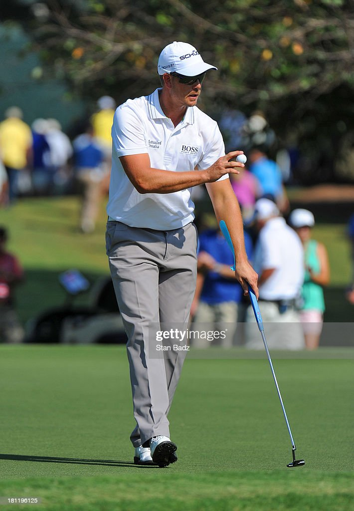 Henrik Stenson of Sweden waves his golf ball as he exits the tenth hole during the first round of the TOUR Championship by Coca-Cola, the final event of the PGA TOUR Playoffs for the FedExCup, at East Lake Golf Club on September 19, 2013 in Atlanta, Georgia.