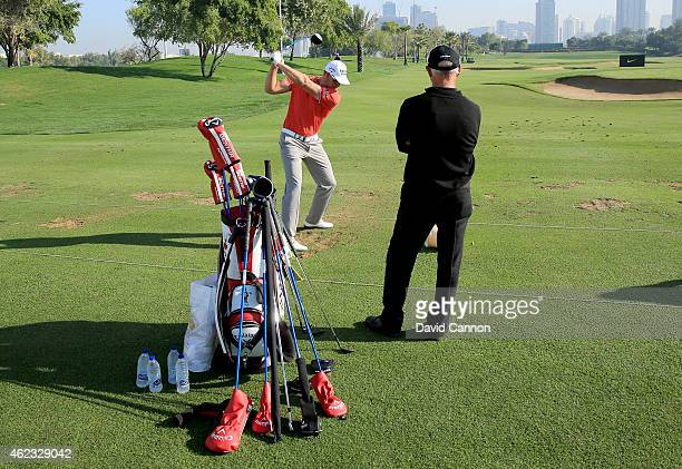 Henrik Stenson of Sweden working on teh driving range with his coach Pete Cowen as a preview for the 2015 Dubai Desrt Classic on the Majlis Course at...