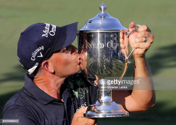 Henrik Stenson poses with the trophy after winning the Wyndham Championship during the final round at Sedgefield Country Club on August 20 2017 in...