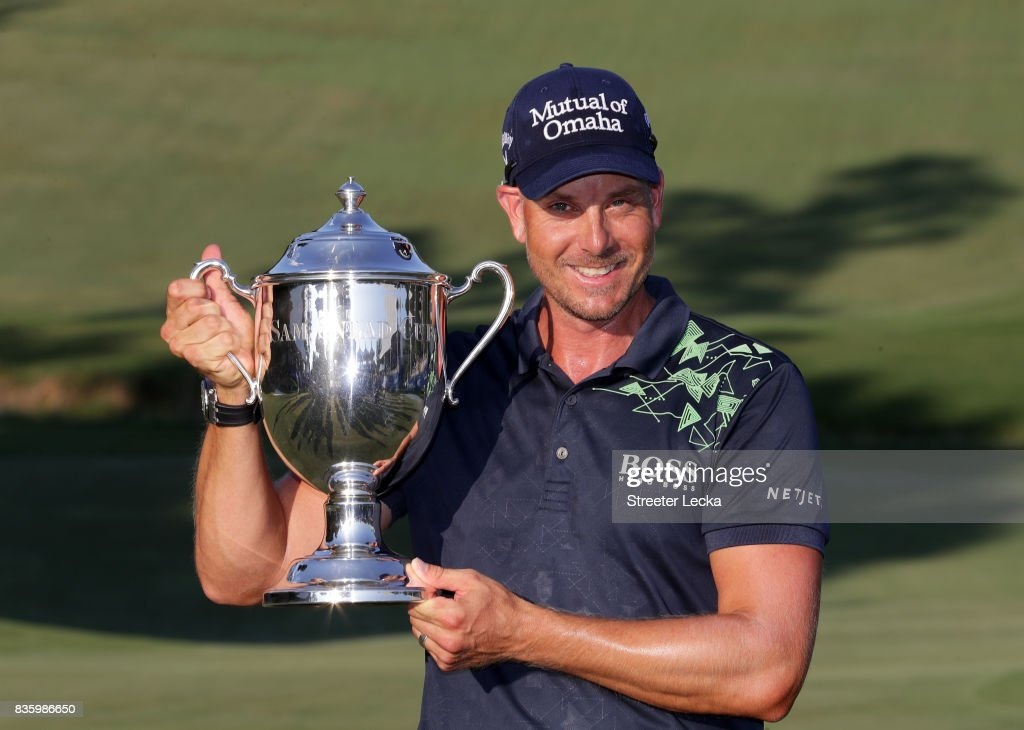 Henrik Stenson poses with the trophy after winning the Wyndham Championship during the final round at Sedgefield Country Club on August 20, 2017 in Greensboro, North Carolina.