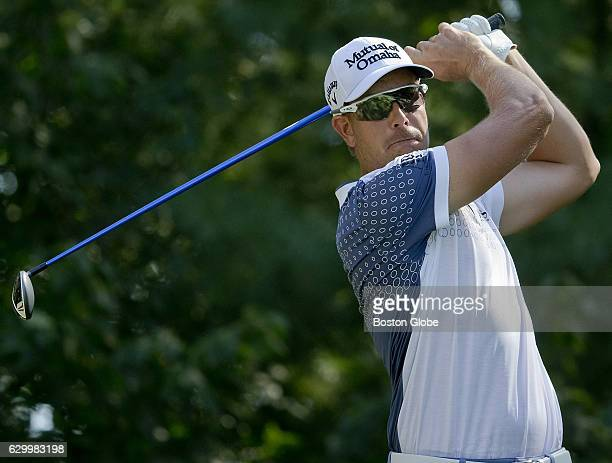 Henrik Stenson watches the flight of his tee shot on the 9th hole during the thirdround action at the Deutsche Bank Championship at TPC Boston in...