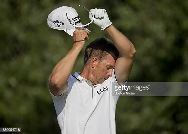 Henrik Stenson wipes his head before hitting his tee shot on the 14th hole during the finalround action of the Deutsche Bank Championship at TPC...