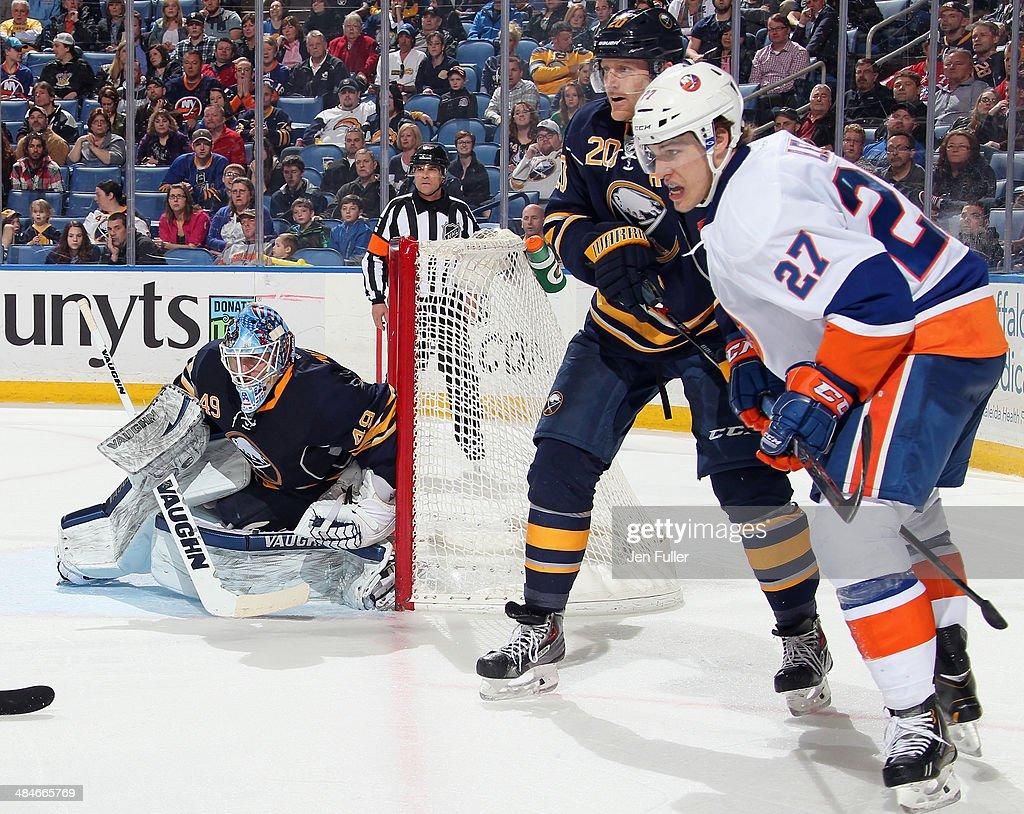 Henrik Tallinder #20 and Connor Knapp #49 of the Buffalo Sabres defend the net against Anders Lee #27 of the New York Islanders at First Niagara Center on April 13, 2014 in Buffalo, New York. New York defeated Buffalo 4-3.