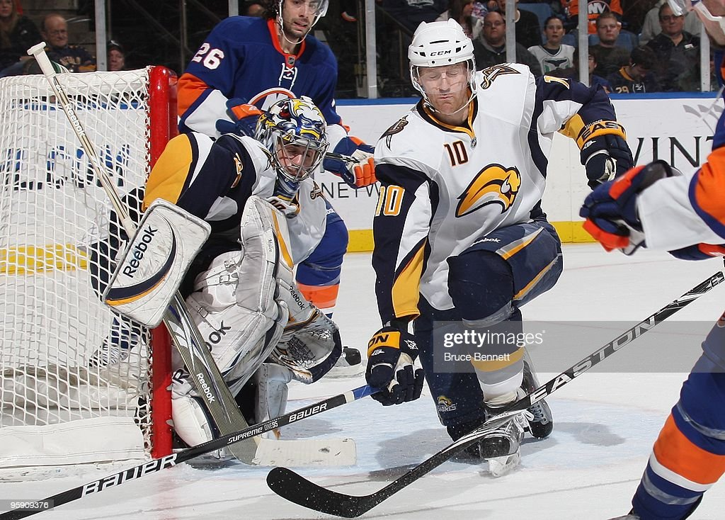 Henrik Tallinder and goaltender Ryan Miller of the Buffalo Sabres guard the net against the New York Islanders at the Nassau Coliseum on January 16...