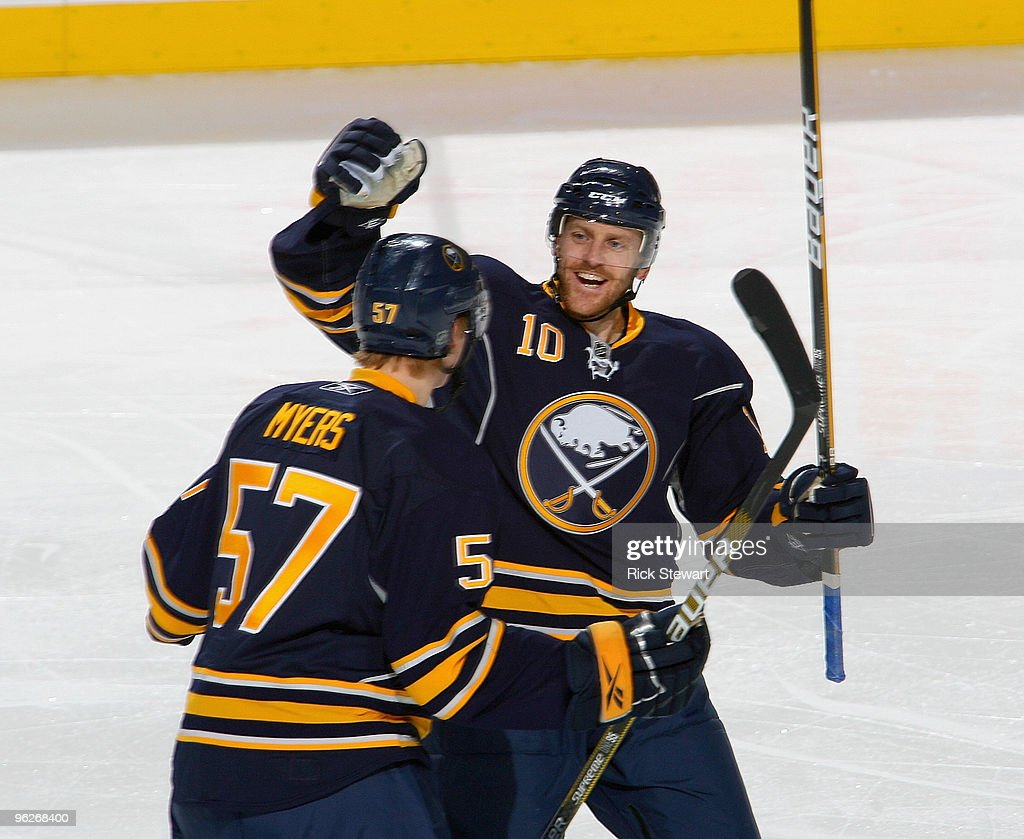 Henrik Tallinder #10 and Tyler Myers #57 of the Buffalo Sabres celebrate Tallinder's goal in the first period against the Boston Bruins at HSBC Arena on January 29, 2010 in Buffalo, New York.