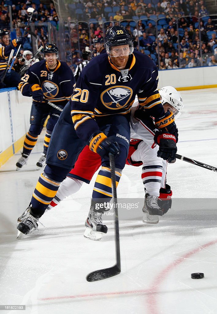 <a gi-track='captionPersonalityLinkClicked' href=/galleries/search?phrase=Henrik+Tallinder&family=editorial&specificpeople=204661 ng-click='$event.stopPropagation()'>Henrik Tallinder</a> #20 of the Buffalo Sabres chases the puck in front of Matt Calvert #11 of the Columbus Blue Jackets during their preseason game at First Niagara Center on September 25, 2013 in Buffalo, New York. Buffalo defeated Columbus, 3-0.