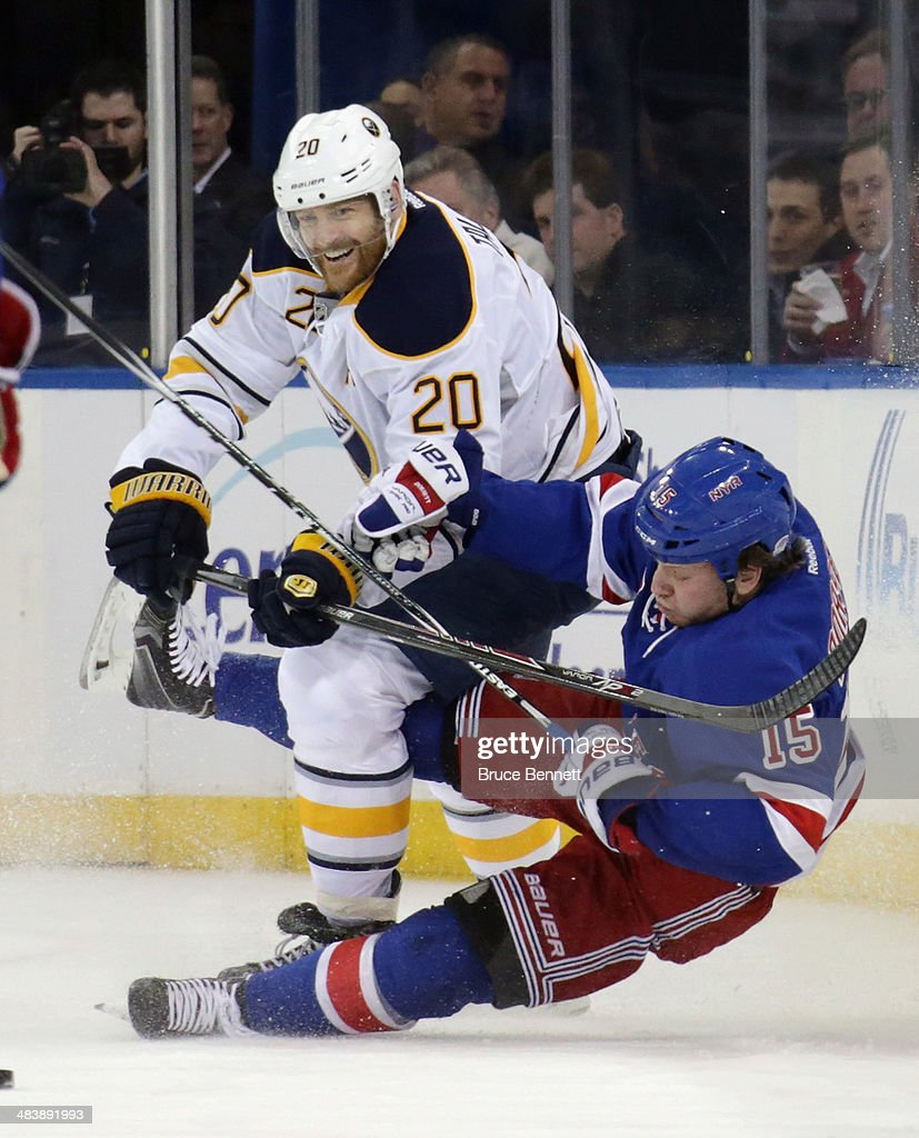 <a gi-track='captionPersonalityLinkClicked' href=/galleries/search?phrase=Henrik+Tallinder&family=editorial&specificpeople=204661 ng-click='$event.stopPropagation()'>Henrik Tallinder</a> #20 of the Buffalo Sabres trips up <a gi-track='captionPersonalityLinkClicked' href=/galleries/search?phrase=Derek+Dorsett&family=editorial&specificpeople=4306277 ng-click='$event.stopPropagation()'>Derek Dorsett</a> #15 of the New York Rangers during the first period at Madison Square Garden on April 10, 2014 in New York City.