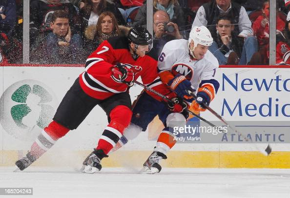 Henrik Tallinder of the New Jersey Devils and Marty Reasoner of the New York Islanders battle for position during the game at the Prudential Center...