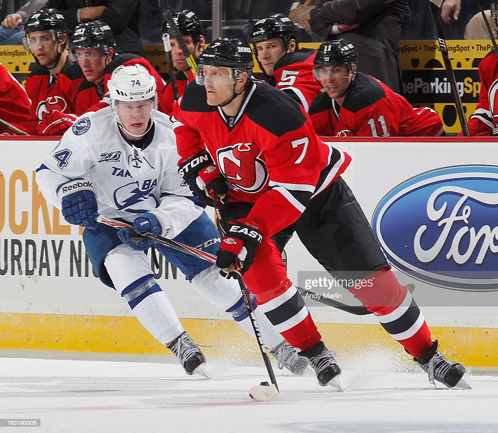 <a gi-track='captionPersonalityLinkClicked' href=/galleries/search?phrase=Henrik+Tallinder&family=editorial&specificpeople=204661 ng-click='$event.stopPropagation()'>Henrik Tallinder</a> #7 of the New Jersey Devils plays the puck while being defended by Ondrej Palat #74 of the Tampa Bay Lightning during the game at the Prudential Center on March 5, 2013 in Newark, New Jersey.