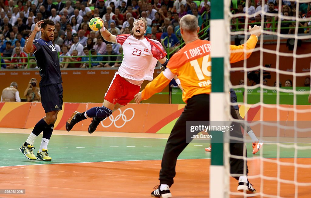 Henrik Toft Hansen of Denmark jumps to shoot against Thierry Omeyer of France during the first half in the Men's Gold Medal Match between Denmark and France on Day 16 of the Rio 2016 Olympic Games at Future Arena on August 21, 2016 in Rio de Janeiro, Brazil.