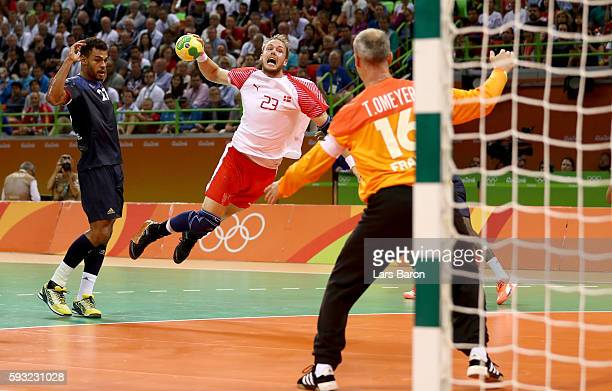 Henrik Toft Hansen of Denmark jumps to shoot against Thierry Omeyer of France during the first half in the Men's Gold Medal Match between Denmark and...