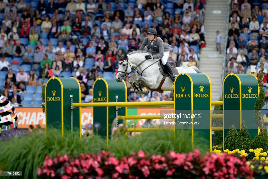 Henrik von Eckermann of Sweden and his horse Coupe de Coeur 2 compete in the RWE Prize of North-Rhine-Westphalia jumping competition during day four of the 2012 CHIO Aachen tournament on July 6, 2012 in Aachen, Germany.