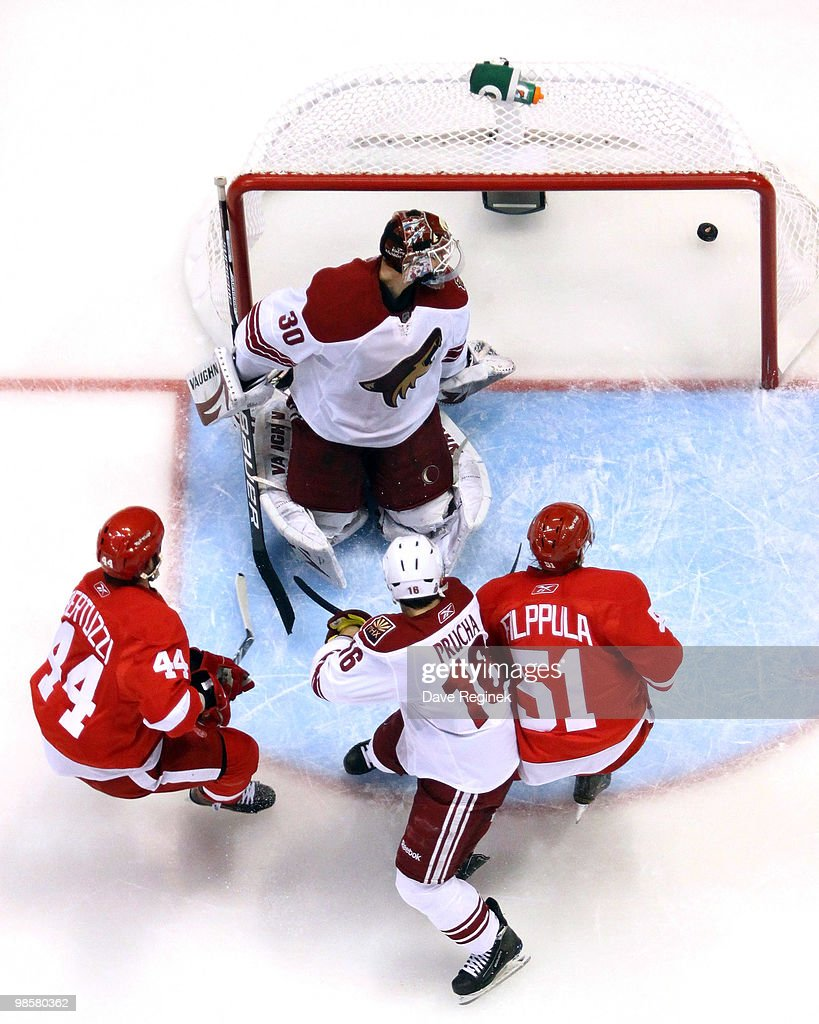 Henrik Zetterberg of the Detroit Red Wings scores as teammates Todd Bertuzzi and Valtteri Filppula along with Petr Prucha of the Phoenix Coyotes...