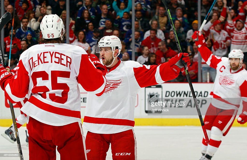 <a gi-track='captionPersonalityLinkClicked' href=/galleries/search?phrase=Henrik+Zetterberg&family=editorial&specificpeople=201520 ng-click='$event.stopPropagation()'>Henrik Zetterberg</a> #40 and Danny DeKeyser #65 congratulate <a gi-track='captionPersonalityLinkClicked' href=/galleries/search?phrase=Tomas+Tatar&family=editorial&specificpeople=5652303 ng-click='$event.stopPropagation()'>Tomas Tatar</a> #21 of the Detroit Red Wings who scored against the Vancouver Canucks during their NHL game at Rogers Arena January 3, 2015 in Vancouver, British Columbia, Canada. Vancouver won 4-1.