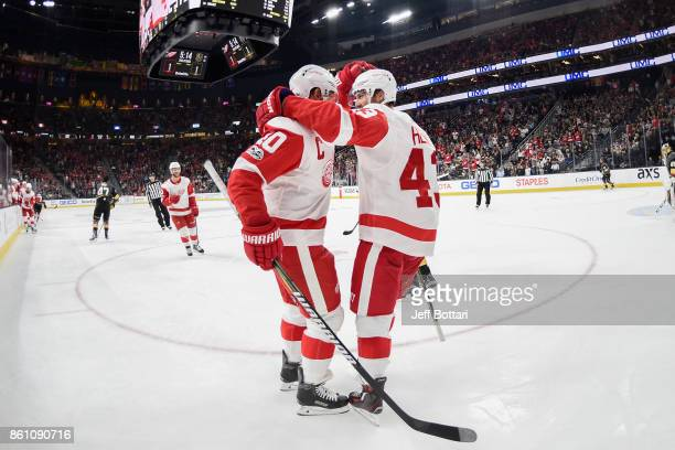 Henrik Zetterberg and Darren Helm of the Detroit Red Wings celebrate after scoring a goal against the Vegas Golden Knights during the game at TMobile...