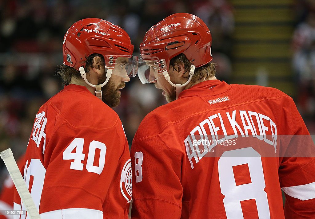 <a gi-track='captionPersonalityLinkClicked' href=/galleries/search?phrase=Henrik+Zetterberg&family=editorial&specificpeople=201520 ng-click='$event.stopPropagation()'>Henrik Zetterberg</a> #40 and <a gi-track='captionPersonalityLinkClicked' href=/galleries/search?phrase=Justin+Abdelkader&family=editorial&specificpeople=2271858 ng-click='$event.stopPropagation()'>Justin Abdelkader</a> #8 of the Detroit Red Wings talk during the first period of the game against the Montreal Canadiens at Joe Louis Arena on January 24, 2014 in Detroit, Michigan. The Wings defeated the Canadiens 4-1.